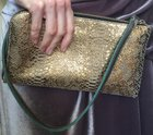 CLUTCH WITH STRAP Gold snake print leather